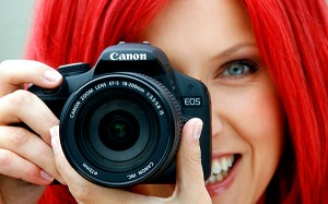 red-hair-girl-with-photo-camera-1920-1200-7829-300x187